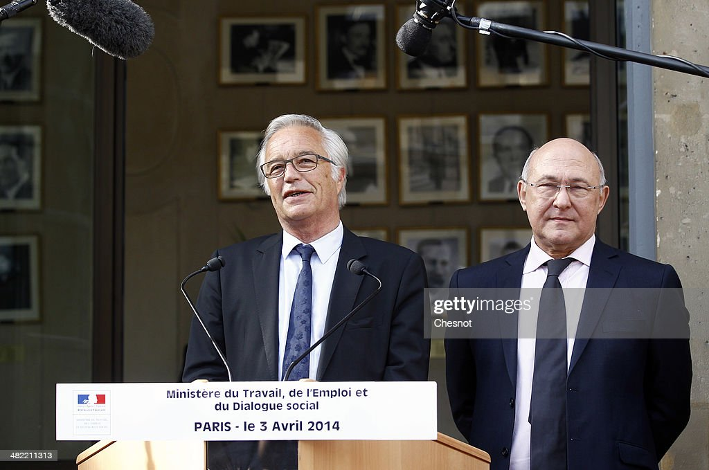 Newly appointed French Labour Minister Francois Rebsamen (L) attends a handover ceremony with outgoing French Minister <a gi-track='captionPersonalityLinkClicked' href=/galleries/search?phrase=Michel+Sapin&family=editorial&specificpeople=668944 ng-click='$event.stopPropagation()'>Michel Sapin</a> at the Ministry in Paris on April 3, 2014, in Paris, France. France's newly reshuffled government took a combative tone with Brussels.