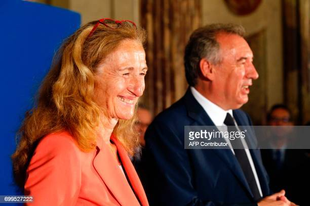 Newly appointed French Minister of Justice Nicole Belloubet reacts as outgoing French Minister of Justice and Leader of the French MoDem centrist...
