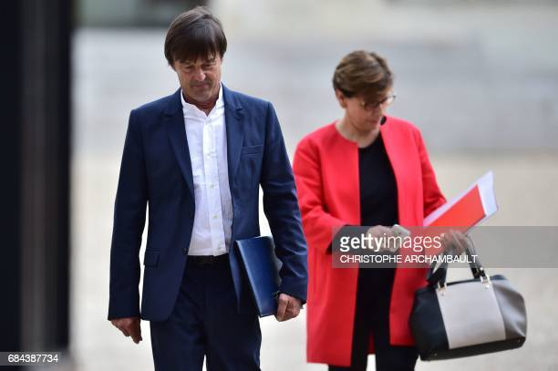 Newly appointed French Minister of the Ecological and Social Transition Nicolas Hulot leaves the Elysee presidential palace in Paris on May 18 after...