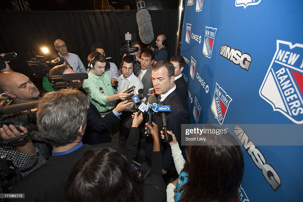 Newly appointed head coach of the New York Rangers, <a gi-track='captionPersonalityLinkClicked' href=/galleries/search?phrase=Alain+Vigneault&family=editorial&specificpeople=4146583 ng-click='$event.stopPropagation()'>Alain Vigneault</a>, answers media quesions at a press conference at Radio City Music Hall on June 21, 2013 in New York City.