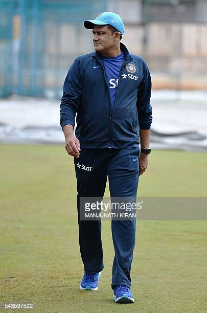 Newly appointed Indian cricket team head coach Anil Kumble returns after inspecting the ground at the National Cricket Academy where the Indian...