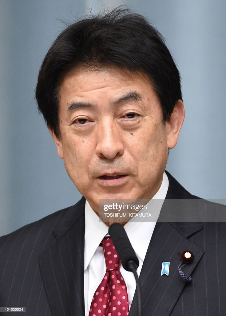 Newly appointed Japanese Health, Labour and Welfare Minister Yasuhisa Shiozaki speaks during his press conference at the prime minister's official residence in Tokyo on September 3, 2014. Japanese Prime Minister Shinzo Abe named five female cabinet ministers on September 3, leading by example in a country which economists say must make better use of its highly-educated but underemployed women.