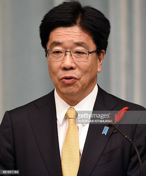 Newly appointed Japanese Minister in charge of encouraging greater workforce participation Katsunobu Kato speaks during his press conference...