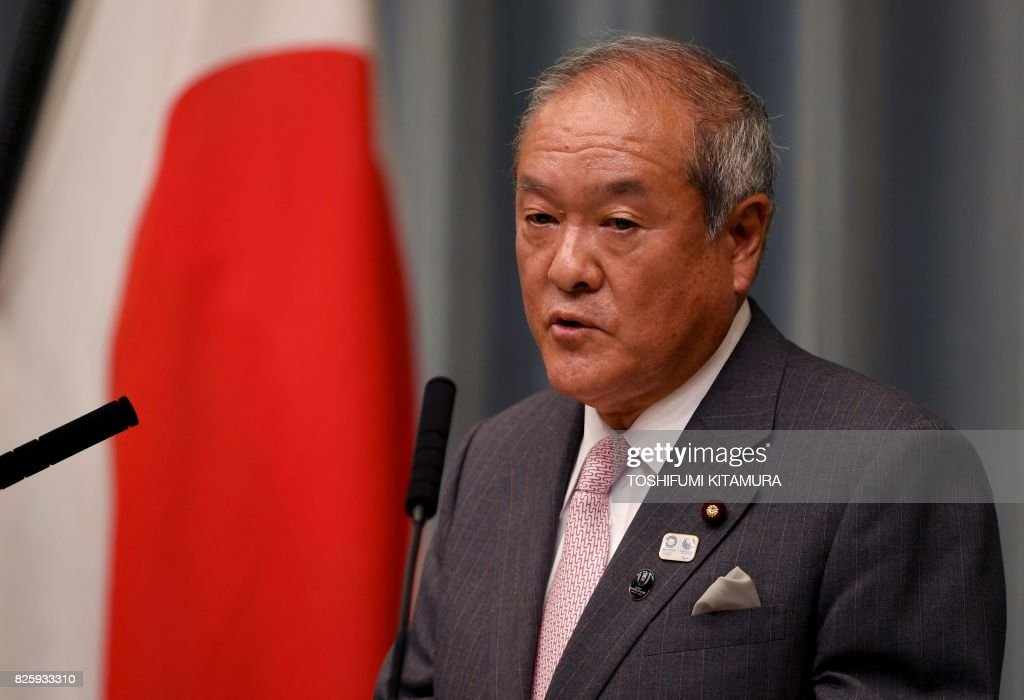 Newly appointed Japanese Minister in charge of the Tokyo Olympic and Paralympic Games Shunichi Suzuki delivers a speech during a press conference at the prime minister's official residence in Tokyo...