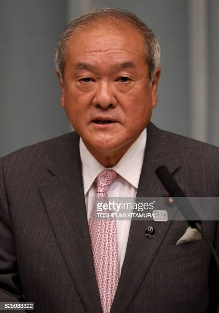Newly appointed Japanese Minister in charge of the Tokyo Olympic and Paralympic Games Shunichi Suzuki delivers a speech during a press conference at...