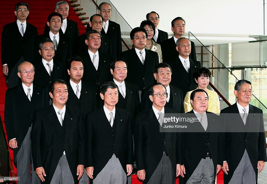 Newly appointed Japanese Prime Minister Yasuo Fukuda poses for photographers with the members of his cabinet at the Prime Minister's official...