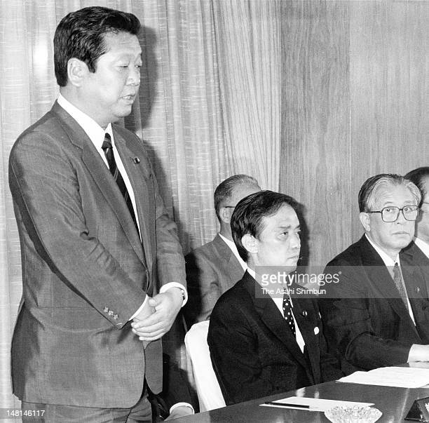 Newly Appointed Liberal Democratic Party Ichiro Ozawa addresses while Prime Minister Toshiki Kaifu listens at the LDP headquarters on August 9 1989...