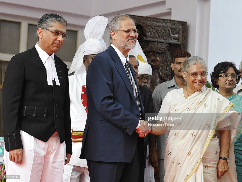 Newly appointed Lieutenant Governor of Delhi, Najeeb Jung, shake hand with Delhi Chief Minister Sheila Dikshit with Chief Justice of the Delhi High Court Justice Badar Durrez Ahmed (L) after taking oath at a ceremony at Raj Bhawan on July 9, 2013 in New Delhi, India. 62-year-old Jung has become the 19th Lt Governor of Delhi. A 1973-batch IAS officer, Jung served in Madhya Pradesh government and at several key positions including as joint secretary in the ministry of Petroleum and Natural gas in Central government.