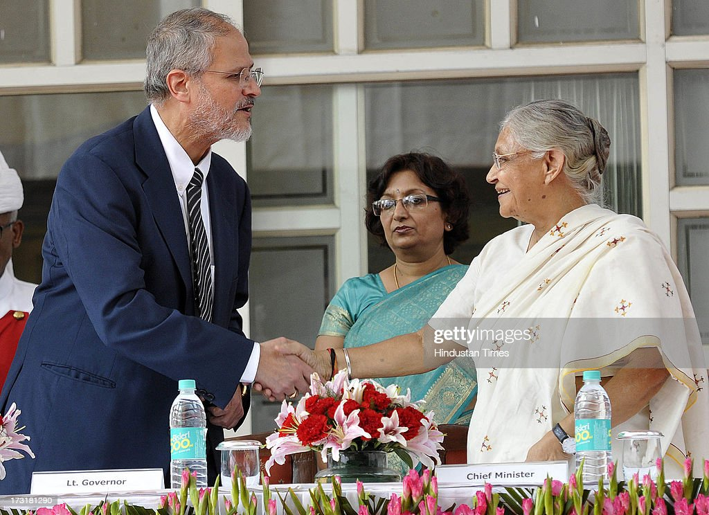 Newly appointed Lieutenant Governor of Delhi, Najeeb Jung, shake hand with Delhi Chief Minister Sheila Dikshit after taking oath at Raj Bhawan on July 9, 2013 in New Delhi, India. 62-year-old Jung has become the 19th Lt Governor of Delhi. A 1973-batch IAS officer, Jung served in Madhya Pradesh government and at several key positions including as joint secretary in the ministry of Petroleum and Natural gas in Central government.