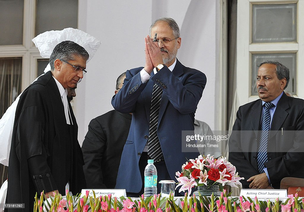 Newly appointed Lieutenant Governor of Delhi, Najeeb Jung, taking oath by Chief Justice of the Delhi High Court Justice Badar Durrez Ahmed during a ceremony at Raj Bhawan on July 9, 2013 in New Delhi, India. 62-year-old Jung has become the 19th Lt Governor of Delhi. A 1973-batch IAS officer, Jung served in Madhya Pradesh government and at several key positions including as joint secretary in the ministry of Petroleum and Natural gas in Central government.