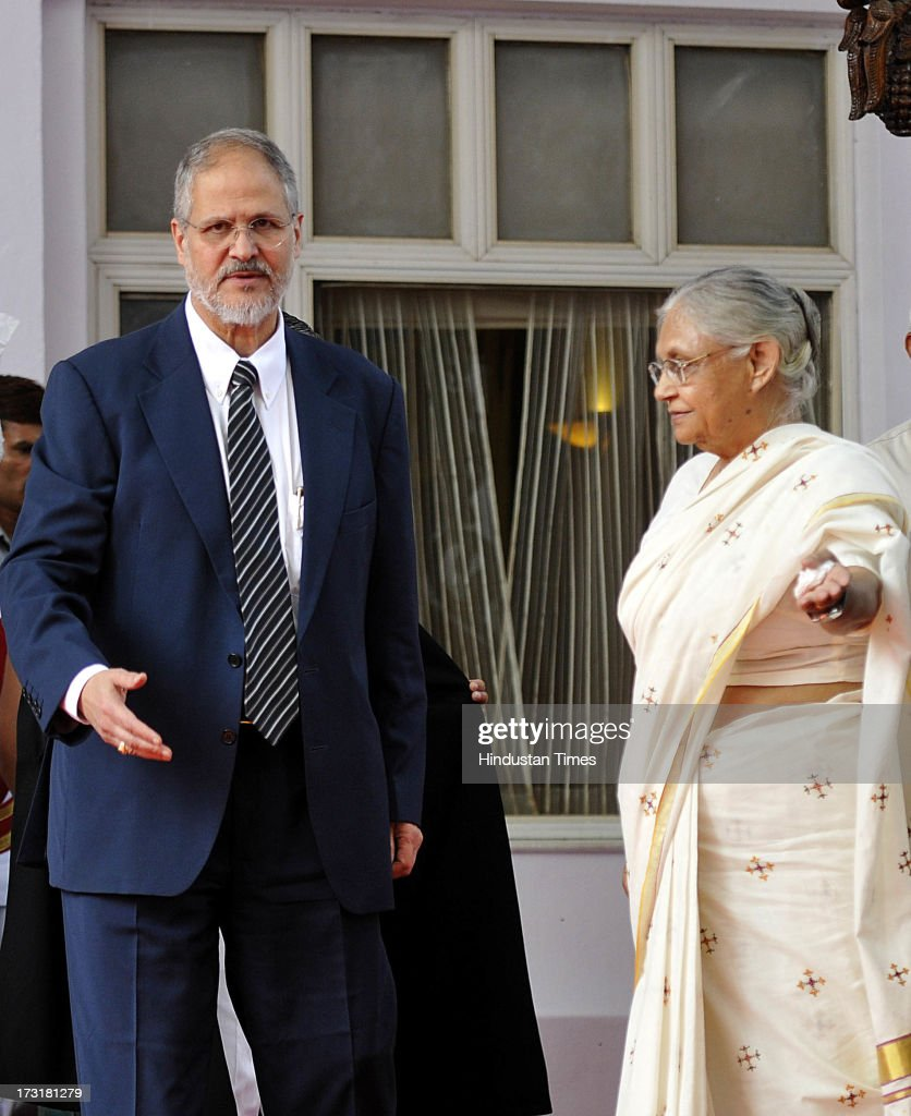Newly appointed Lieutenant Governor of Delhi, Najeeb Jung, with Delhi Chief Minister Sheila Dikshit after taking oath at a ceremony at Raj Bhawan on July 9, 2013 in New Delhi, India. 62-year-old Jung has become the 19th Lt Governor of Delhi. A 1973-batch IAS officer, Jung served in Madhya Pradesh government and at several key positions including as joint secretary in the ministry of Petroleum and Natural gas in Central government.