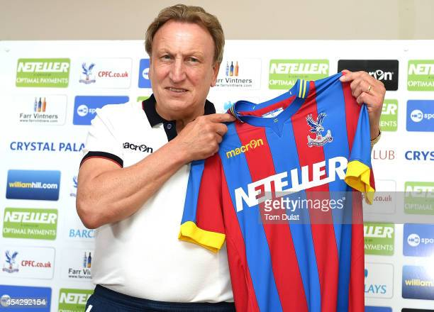 Newly appointed manager of Crystal Palace Neil Warnock poses for photographs during a press conference at Crystal Palace Training Ground on August 28...