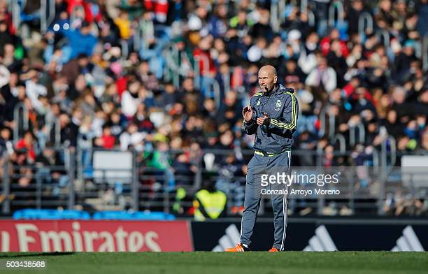 Newly appointed manager of Real Madrid Zinedine Zidane looks on during a Real Madrid training session at Valdebebas training ground on January 5 2016...
