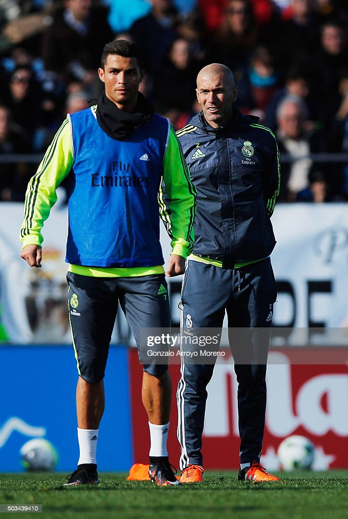 Newly appointed manager of Real Madrid <a gi-track='captionPersonalityLinkClicked' href=/galleries/search?phrase=Zinedine+Zidane&family=editorial&specificpeople=172012 ng-click='$event.stopPropagation()'>Zinedine Zidane</a> looks on alongside <a gi-track='captionPersonalityLinkClicked' href=/galleries/search?phrase=Cristiano+Ronaldo+-+Soccer+Player&family=editorial&specificpeople=162689 ng-click='$event.stopPropagation()'>Cristiano Ronaldo</a> during a Real Madrid training session at Valdebebas training ground on January 5, 2016 in Madrid, Spain.