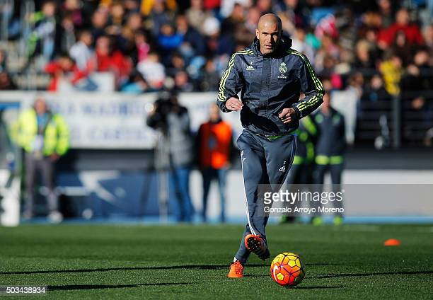 Newly appointed manager of Real Madrid Zinedine Zidane passes the ball during a Real Madrid training session at Valdebebas training ground on January...