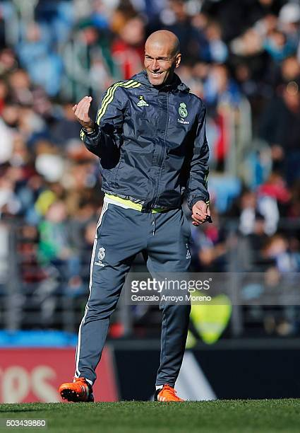 Newly appointed manager of Real Madrid Zinedine Zidane signals during a Real Madrid training session at Valdebebas training ground on January 5 2016...