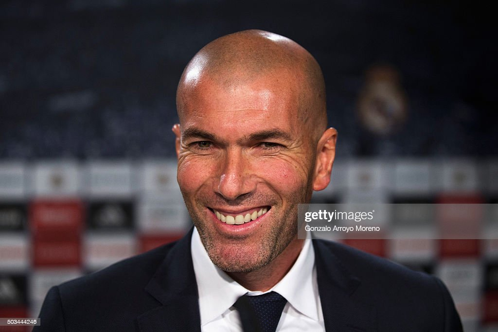 Newly appointed manager of Real Madrid <a gi-track='captionPersonalityLinkClicked' href=/galleries/search?phrase=Zinedine+Zidane&family=editorial&specificpeople=172012 ng-click='$event.stopPropagation()'>Zinedine Zidane</a> smiles during a Real Madrid press conference at Valdebebas training ground on January 5, 2016 in Madrid, Spain.
