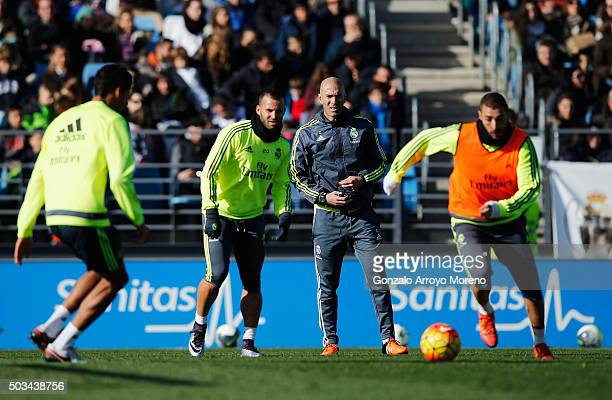 Newly appointed manager of Real Madrid Zinedine Zidane watches his players during a Real Madrid training session at Valdebebas training ground on...