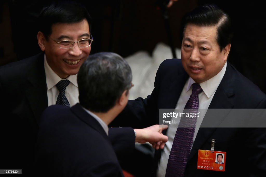 Newly appointed minister of industry and information technology Miao Wei (L), People's Bank of China Governor <a gi-track='captionPersonalityLinkClicked' href=/galleries/search?phrase=Zhou+Xiaochuan&family=editorial&specificpeople=781144 ng-click='$event.stopPropagation()'>Zhou Xiaochuan</a> (C) and minister of environmental protection <a gi-track='captionPersonalityLinkClicked' href=/galleries/search?phrase=Zhou+Shengxian&family=editorial&specificpeople=601307 ng-click='$event.stopPropagation()'>Zhou Shengxian</a> (R) chat during the sixth plenary meeting of the National People's Congress at the Great Hall of the People on March 16, 2013 in Beijing, China. The new lineup of China's State Council, nominated by Premier Li Keqiang, was endorsed by lawmakers at the ongoing national legislative session Saturday afternoon.