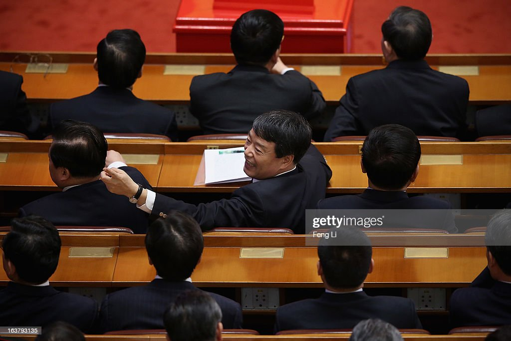 Newly appointed Minister of the National Development and Reform Commission Xu Shaoshi (C) attends the sixth plenary meeting of the National People's Congress at the Great Hall of the People on March 16, 2013 in Beijing, China. The new lineup of China's State Council, nominated by Premier Li Keqiang, was endorsed by lawmakers at the ongoing national legislative session Saturday afternoon.
