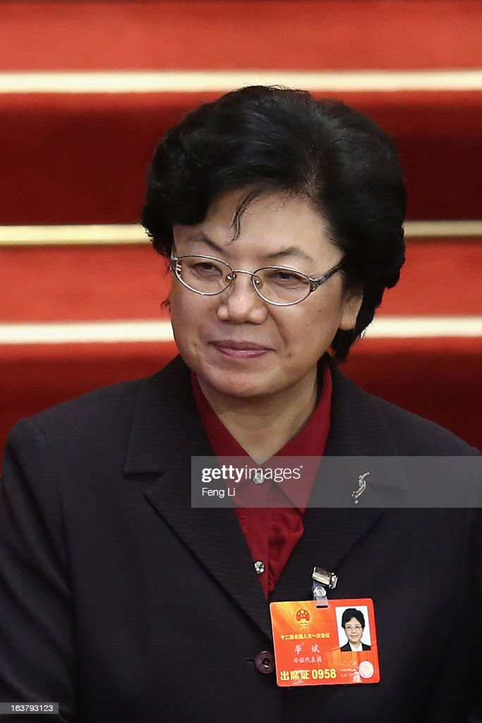 Newly appointed Minister of the National Health and Family Planning Commission <a gi-track='captionPersonalityLinkClicked' href=/galleries/search?phrase=Li+Bin&family=editorial&specificpeople=227305 ng-click='$event.stopPropagation()'>Li Bin</a> leaves after the sixth plenary meeting of the National People's Congress at the Great Hall of the People on March 16, 2013 in Beijing, China. The new lineup of China's State Council, nominated by Premier Li Keqiang, was endorsed by lawmakers at the ongoing national legislative session Saturday afternoon.