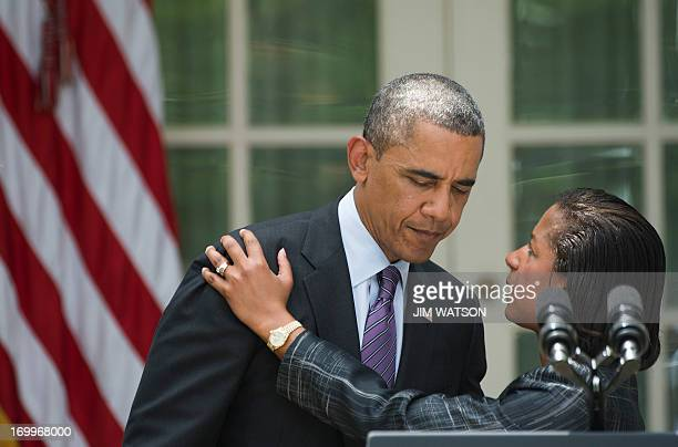 Newly appointed National Security Advisor Susan Rice embraces US President Barack Obama after he made the announcement during an event in the Rose...