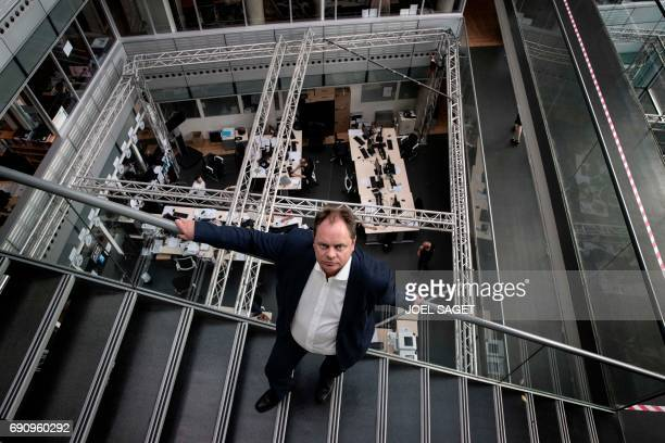 TOPSHOT Newly appointed news director of the French staterun television group 'France Televisions' Yannick Letranchant poses during a photo session...