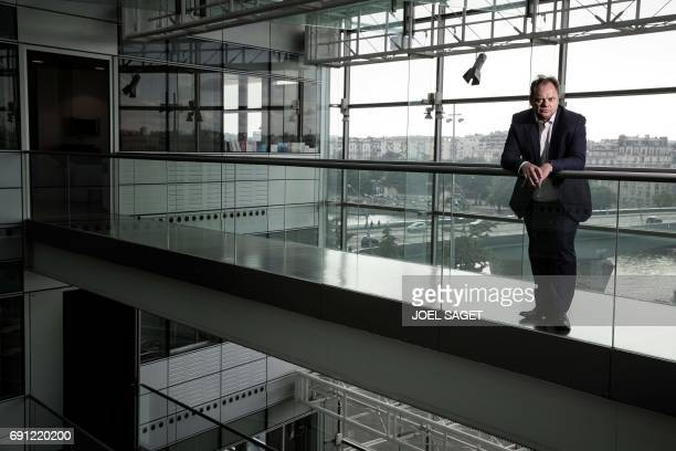 Newly appointed news director of the French staterun television group 'France Televisions' Yannick Letranchant poses during a photo session on May 31...