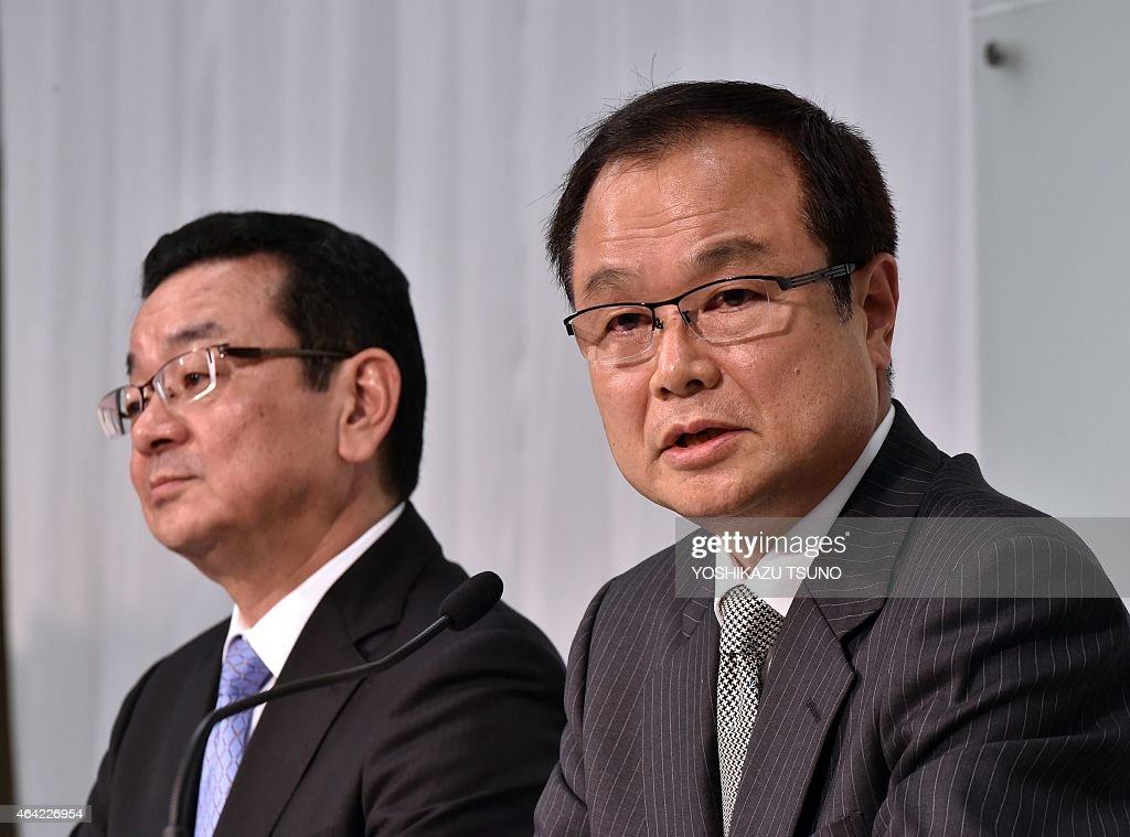 Newly appointed president of Japanese carmaker Honda Takahiro Hachigo (L) listens as current president <a gi-track='captionPersonalityLinkClicked' href=/galleries/search?phrase=Takanobu+Ito&family=editorial&specificpeople=5696906 ng-click='$event.stopPropagation()'>Takanobu Ito</a> (R) speaks during a press conference at the company's headquarters in Tokyo on February 23, 2015. Honda said on February 23 that its president was stepping down as the firm grapples with an exploding air bag crisis linked to at least five deaths that also led to the recall of millions of vehicles. AFP PHOTO / Yoshikazu TSUNO