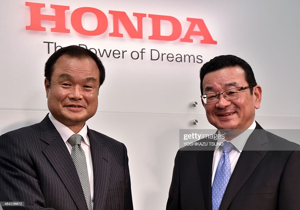 Newly appointed president of Japanese carmaker Honda Takahiro Hachigo (R) smiles with current president <a gi-track='captionPersonalityLinkClicked' href=/galleries/search?phrase=Takanobu+Ito&family=editorial&specificpeople=5696906 ng-click='$event.stopPropagation()'>Takanobu Ito</a> (L) during a press conference at the company's headquarters in Tokyo on February 23, 2015. Honda said on February 23 that its president was stepping down as the firm grapples with an exploding air bag crisis linked to at least five deaths that also led to the recall of millions of vehicles. AFP PHOTO / Yoshikazu TSUNO