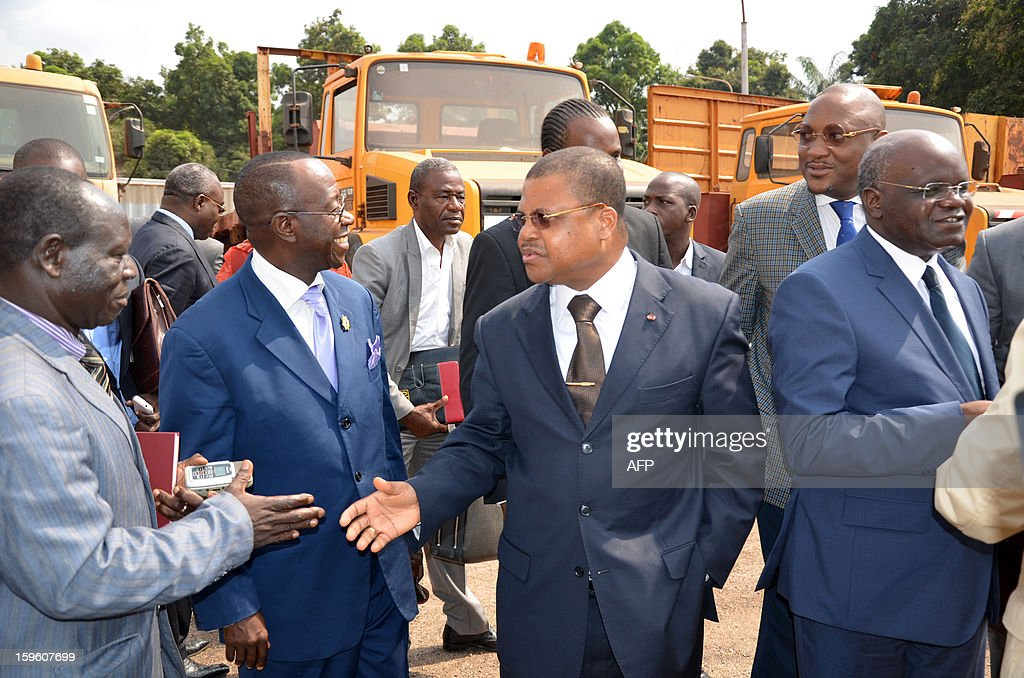 Newly appointed Prime Minister Nicolas Tiangaye (C) shakes hands on January 17, 2013 in Bangui after a ceremony. Opposition figure Nicolas Tiangaye was officially appointed today Prime Minister of the Central African Republic's new national unity government, President Francois Bozize said after a ceremony in the capital Bangui. The announcement was in line with a peace deal struck between the ruling party, the Seleka rebels and the democratic opposition in the Gabonese capital of Libreville last week.