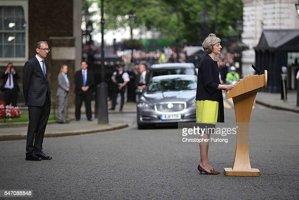 Newly appointed Prime Minister Theresa May with her husband Philip looking on speaks with the press as they arrive at 10 Downing Street on July 13...