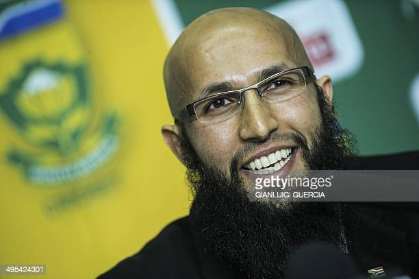 Newly appointed South African cricket Test team Hashim Amla smiles during a press briefing following his appointment on June 3 2014 at the Sandton...