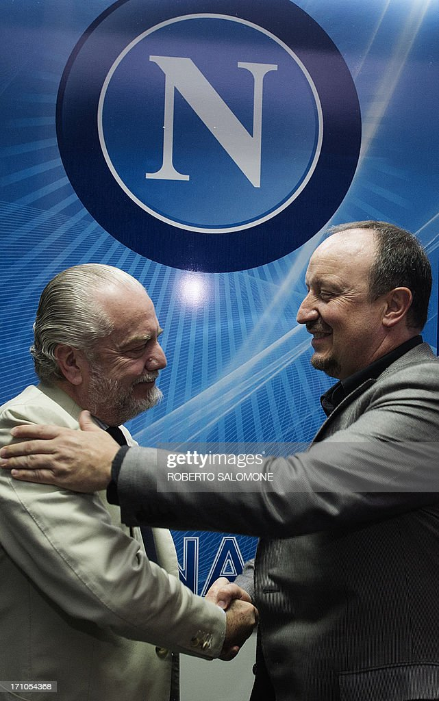 Newly appointed SSC Napoli coach Spanish Rafael Benitez (R) shakes hands with SSC Napoli president Aurelio De Laurentiis (L) during his first press conference in SSC Napoli's training camp in Castelvolturno in the outskirts of the city of Naples on June 21, 2013. The 53-year-old Spaniard has signed a two-year contract with the Italian club and succeeds Walter Mazzarri, who has joined one of Benitez's former clubs, Inter Milan.