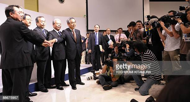 Newly appointed Toyota Motors President Akio Toyoda and his vice presidents Shinichi Sasaki Yukitoshi Funo Takeshi Uchiyamada Atsushi Niimi and...