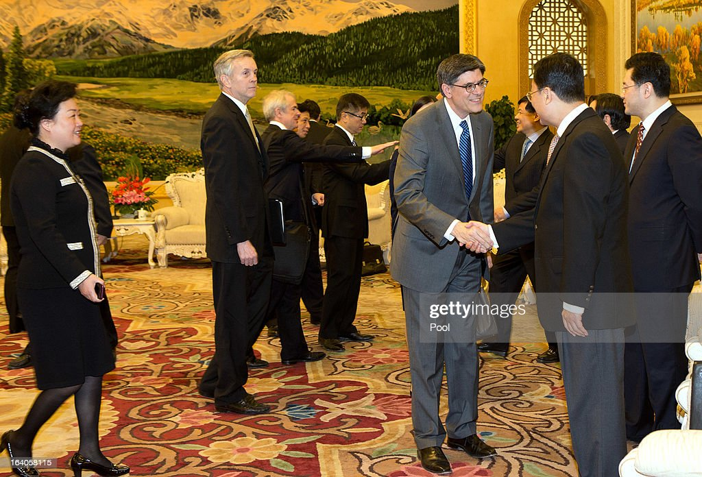 Newly appointed U.S. Treasury Secretary Jacob Lew, (C) shakes hand with Chinese officials during his meeting with Chinese President Xi Jinping (not pictured) during his visit to the Great Hall of the People on March 19, 2013 in Beijing, China. Chinese leader Xi Jinping spoke of wanting strong ties with the U.S. after holding talks with the US Treasury secretary Jacob Lew today in his first meeting with a foreign official since being appointed as president.