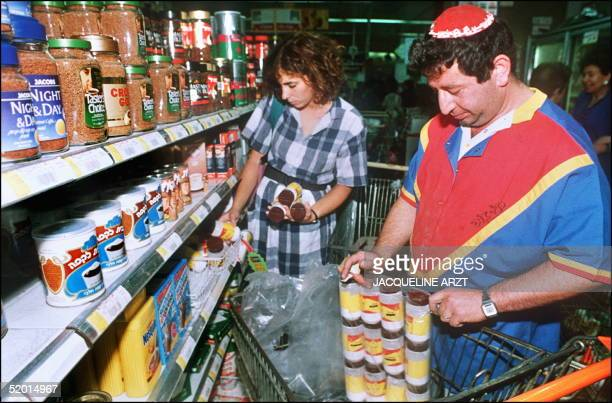 A newly arrived American immigrant from Washington DC buys 26 August 1990 baking soda that mixed with water and applied with a cloth to the mouth and...