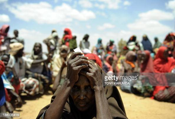 A newly arrived elderly Somali woman waits with others new arrivals to be registered as refugees in Doolow south western Somalia UN refugee agency...