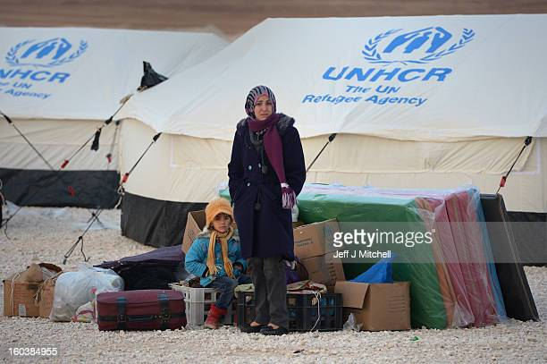ZA'ATARI JORDAN JANUARY 30 Newly arrived refugees from Syria wait for tents to go up at the Za'atari refugee camp on January 30 2013 in Mafrq Jordan...