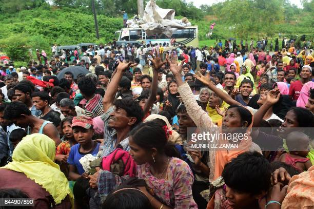 TOPSHOT Newly arrived Rohingya refugees scuffle for relief supplies at Kutupalong refugee camp in the Bangladeshi locality of Ukhia on September 9...