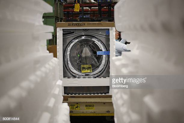 A newly assembled front loading washing machine moves down a conveyor belt before being boxed for shipment at the Whirlpool Corp manufacturing...