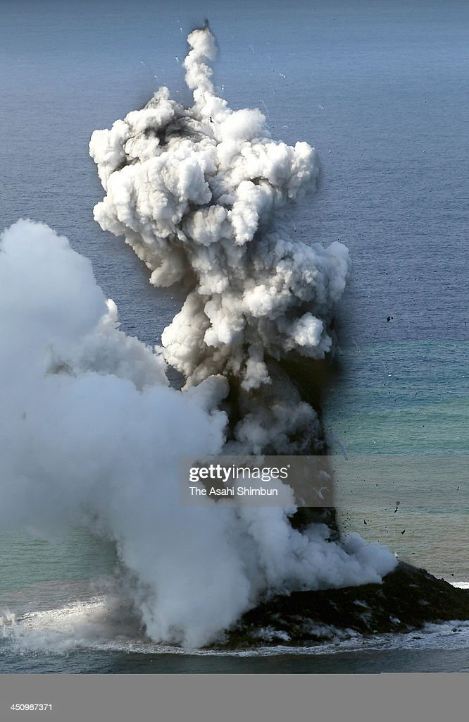 A newly born volcanic island spews jets of steam and ash off the Nishino Shima Island on November 21, 2013 in Ogasawara, Japan. The submarine eruption which gave birth to this new island was first spotted by Japanese navy in the morning at 10:20 local time on November 21, 2013.