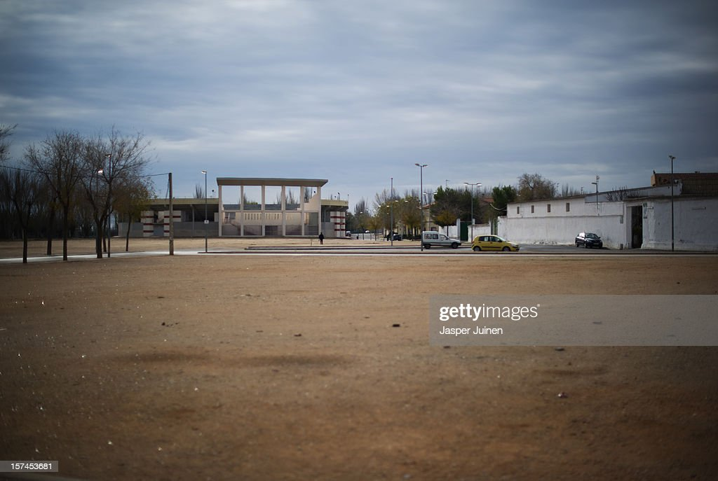 A newly built bullring arena stands deserted on November 30, 2012 in Villacanas, Spain. During the boom years, where in its peak Spain built some 800,000 houses a year accompanied by the manufacturing of millions of wooden doors, the people of Villacanas were part of Spain's middle class enjoying high wages and permanent jobs. During the construction boom years the majority of the doors used within these new developments were made in this small industrial town. Approximately seven million doors a year were once assembled here and the factory employed a workforce of almost 5700 people, but the town is now left almost desolate with the Villacanas industrial park now empty and redundant. With Spain in the grip of recession and the housing bubble burst, Villacanas is typical of many former buoyant industrial Spanish towns now struggling with huge unemployment problems.