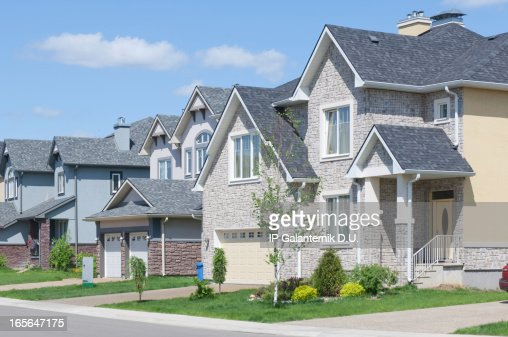 Newly built homes with attached garages and driveways