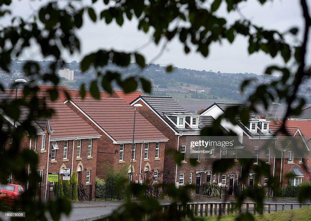 Newly built semi-detached residential houses stands in Newcastle-upon-Tyne, U.K., on Wednesday, Sept. 11, 2013. U.K. house prices rose for a seventh month in August and will probably continue to increase through the rest of the year, according to a report by Halifax. Photographer: Nigel Roddis/Bloomberg via Getty Images