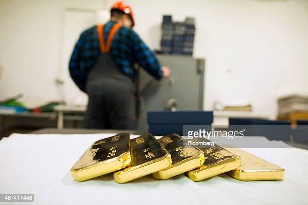 Newly cast gold bullion bars sit in a saferoom ahead of export at the KHGM Polska Miedz SA smelting plant in Glogow Poland on Monday March 23 2015...