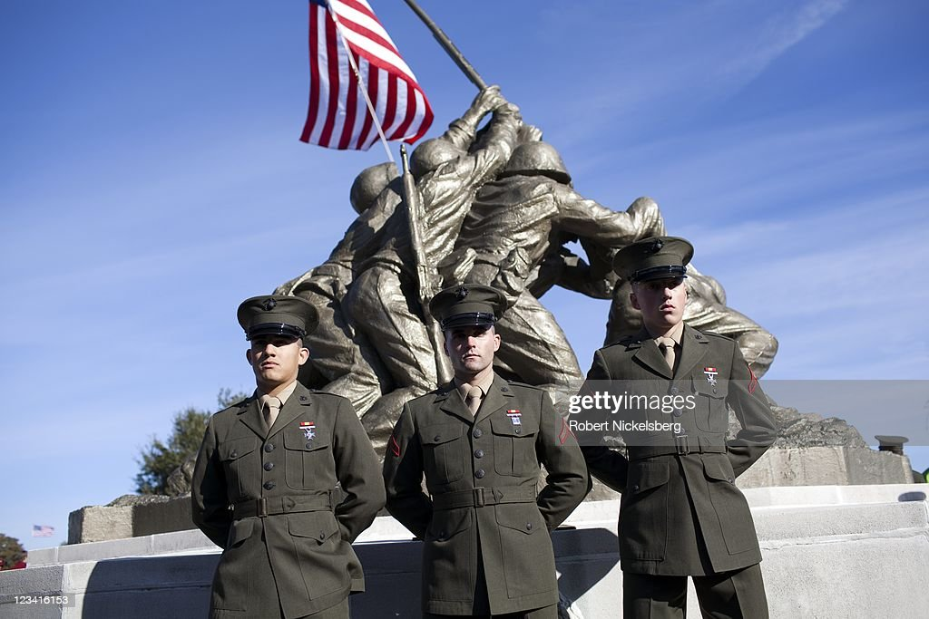 Newly commissioned US Marines have their pictures taken following their graduation ceremony January 7 2011 at the Marine Corps Recruit Depot on...