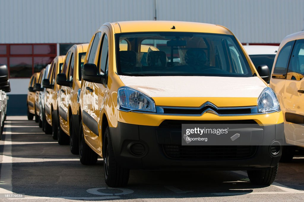 Newly completed Citroen Berlingo automobiles stand in a parking lot before shipment at the PSA Peugeot Citroen production plant in Mangualde, Portugal, on Monday, Sept. 23, 2013. Some economists point to falling labor costs across southern Europe as a sign the region may be becoming more attractive as a manufacturing base. Photographer: Mario Proenca/Bloomberg via Getty Images