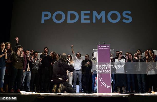 Newly confirmed leader of Podemos a leftwing party that emerged out of the 'Indignants' movement Pablo Iglesias poses with supporters and party...