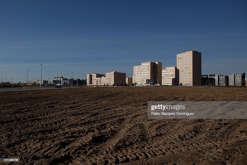 Newly constructed buildings stand next to an empty plot in Alcorcon on December 3, 2012 in Madrid, Spain. Spain has formally requested 39.5 billion euros of European funds to bailout a number of its struggling banks.